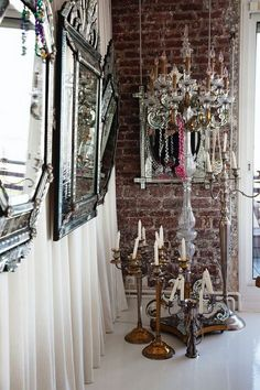For an accent wall in a guest bedroom or master bedroom....I love the idea of draping the entire wall with fabric and hanging beautiful mirrors like these