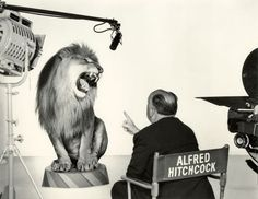 Alfred Hitchcock directs the MGM lion circa 1958, photographed by Sinclair Bull