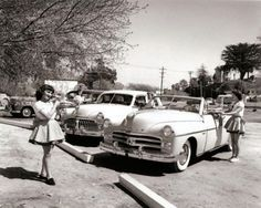 Car hops serving customers at a drive-in restaurant, 1950.