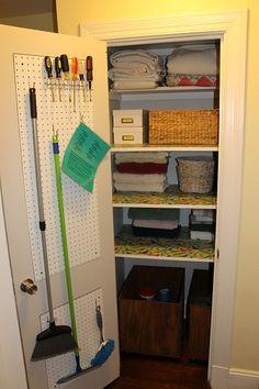 Linen Closet-mops and broom storage, tool box