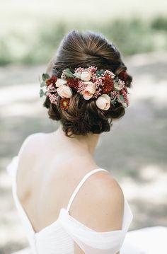 romantic bridal hair flowers - photo by Mackensey Alexander http://ruffledblog.com/romantic-savannah-restaurant-wedding