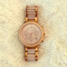 Michael Kors rose gold watch Rose gold watch, with diamonds around the face and a marble like band Michael Kors Jewelry