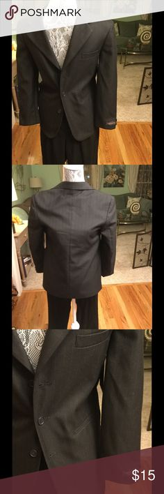 BOYS SUIT JACKET WITH NICE BLACK SLACKS This boys suit jacket did not have matching slacks.  Jacket is a 12 reg. 65% polyester, 35% rayon pants are Cherokee  65% polyester and 35% rayon and a size 12. Comes with both to make a set. unknown Jackets & Coats Blazers