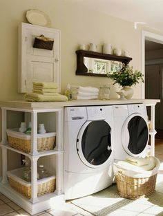 If the laundry center is out in the open, use built-in shelves to contain everything. This three-piece laundry center consists of shelves on either side of the washer and dryer. Use baskets to hold laundry supplies and clothes. Place a countertop above the shelves to serve as a folding station.