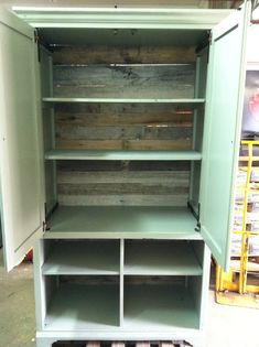 Turn an old armoire into a pantry.