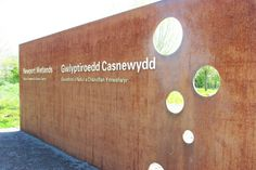 Weathering Steel signage at Newport Wetlands (UK made alternative to Cor-ten steel) - Macgregor Smith Landscape Architects. Design : Kevin Barton