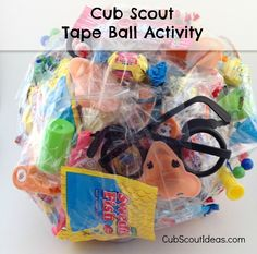 Prizes, competition, candy, boys--they make a great combination! Use this tape ball game for Cub Scout pack or den meetings.