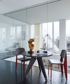 A table and chairs by Jean Prouvé in David's office; the wood sculpture by Mario Dal Fabbro is from Maison Gerard. Duplex Design, Apartment Design, Round Dining Table, A Table, Kitchen Nook Table, Best Interior, Interior Design, New York Penthouse, Jean Prouve
