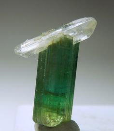 Elbaite  	Quartz Very Aesthetic Size:	 Thumbnail 1.7x1.1x0.9 cm Location:	Cruzeiro Mine Minas Gerais Brazil Description:	A bright green Tourmaline, slightly lighter at the base, with a double terminated Quartz perched on the termination.  The Quartz is tabular, and quite lustrous. The Tourmaline is also lustrous. It is an aesthetic piece. From Brazil.