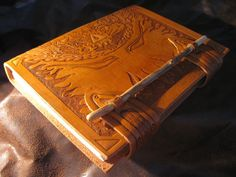 handtooled leather cover by Azenrain on Deviantart      #book_arts   #books