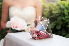 We at Intimate Weddings absolutely love geometric centerpieces, and this diamond shaped display box by Waen via etsy  is no exception. This piece would be perfect with a small candle inside. #weddingdecor