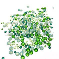 Mixed pack of Swarovski Colour Crystals 400pcs  Colours chosen to compliment each other.  Contains:  Fern Green  - SS7 60pcs  - SS20 50pcs  Emerald  - SS7 60pcs  - SS12 60pcs  Pacific Opal  - SS20 50pcs  Peridot  - SS7 60pcs  -SS12 60pcs