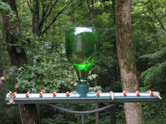 "Now THAT'S a hummingbird feeder! Wish the link had step by step instructions.  Although, if you read several of the comments on the post, a few key questions are answered.  And I think anyone handy could figure it out with the ""comment tips"" and the picture as reference.  I am going to try this!!"