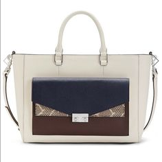 """⭐️HP Best in Bags⭐️Handbag⭐️ 💯% Authentic Tory Burch T-Lock Color Block Tote⭐️NWT⭐️Comes with gift box⭐️Open top with center zip compartment⭐️Saffiano Leather⭐️Interior snap pocket & two open pockets⭐️Interior zip pocket⭐️Top handles have a 4"""" drop⭐️Removable clutch at front with interior pocket and T-lock closures⭐️Height 10"""", Length 13"""" & Depth 5.9""""⭐️🚫No Trades🚫🚫No PayPal🚫 Tory Burch Bags Totes"""