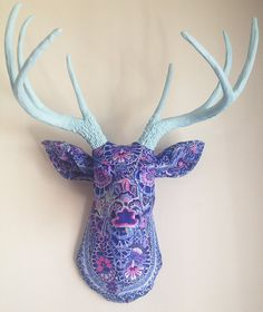 Looking for something to add a burst of color to your room? This one-of-a-kind decoupaged deer head wall mount is sure to deliver! This piece