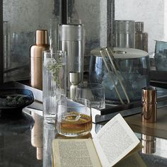 Our seriously stylish Orb mixology collection recalls the decadence and nostalgia of vintage cocktail culture to elevate the home bar. Aaron Probyn's beautiful, functional designs coordinate in an artistic, unexpected mix of metals and multicolored glass.