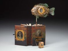 Daniel Essig; FISHEYE | Altered book art, LOVE the spiky fish