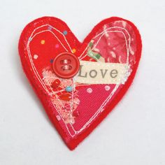 Pretty fabric heart brooch made with vintage fabric in shades of red and finished with vintage lace and a button. The brooch measures approximately x It has a standard silver brooch fastening on the back. Fabric Art, Fabric Crafts, I Love Heart, Love Craft, Love Symbols, Button Crafts, Homemade Crafts, Be My Valentine, Machine Embroidery