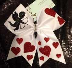 Bows by April - CUPID White Mystique Red Glitter Hearts Valentines Day Cheer Bow, $18.00 (http://www.bowsbyapril.com/cupid-white-mystique-red-glitter-hearts-valentines-day-cheer-bow/)