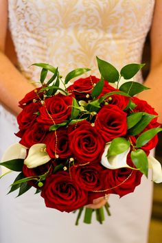 Red rose wedding bouquet. @Jessie Zahn I like the touch of white with the calla lilies, but I like the idea of all roses too.