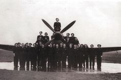 An archive picture of the women of the ATA in front of a plane
