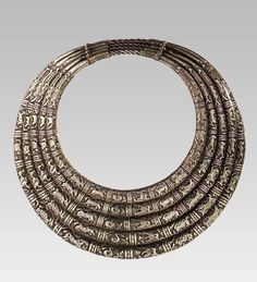 A fine set of five decorated neckrings made by the Miao (SW China) in the 20th (possibly early to mid 20th) century, found on the website of the World Jewelry Museum (Seoul, South Korea).