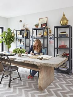 Office - Genevieve Gorder's Big Renovation  on HGTV Like this room.  Large wall idea with a lighter wood desk between.