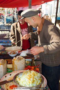 Man preparing noodle dish in Upal, Xinjiang, China | Alfred Molon