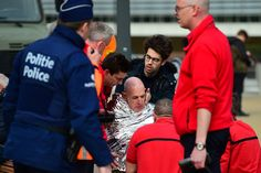 A victim receives first aid near Maelbeek metro station in Brussels, on March 22.
