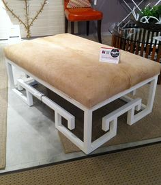 I always think that having a great ottoman / from Van Colier is wonderful with it's geometric base and hide. (available in COM as well)  The open base allows you to really get great size - for a sectional, or a large living setting - and still have a great shape.