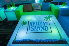 Tropical Island Theme Bat Mitzvah, Blue & Green LED Logo Table {By Balloon Artistry, Sarah Merians Photography} - mazelmoments.com