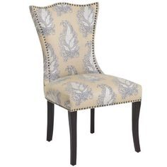 Here's a prediction you can trust—this fully assembled chair will totally transform gatherings around the dining table and in living areas, too. With its hourglass, peaked back, brass nail-head trim, flared birch legs and upholstery that epitomizes comfort <i>and</i> style, we can easily see a Cassandra in your future—believe it.