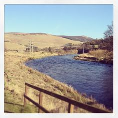 Photo by daniellekatelee  #scotland #hills #cardrona #blue #river #water #rivertweed #gate #pretty #landscape #pictures #sunshine #bluesky #grass #summerscomming #country #walks