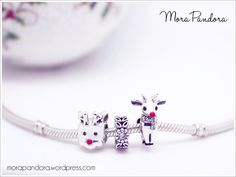 Battle of the reindeer - the Pandora Red-Nosed Reindeer (left) versus the Chamilia Rudolph (right!)