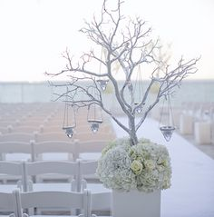 Beautiful whites with extended branches and candlelight create a bold, yet elegant statement, against the beautiful blue skies at The Ritz-Carlton, Fort Lauderdale.