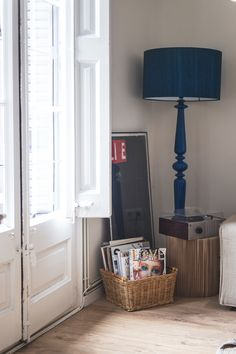 The blue floor lamp in a corner of the living room is from Habitat.