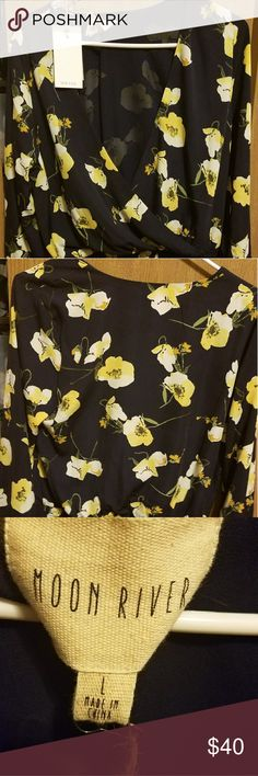 Floral top. Moon River Blouse with elastic waist. Purchase from Saks 5th Ave.  I can't fit this blouse because the sleeves are very tight. If you have muscular or thicker arms it probably won't fit.  Beautiful blouse. I'm crushed that I have to sell it. moo Tops Blouses