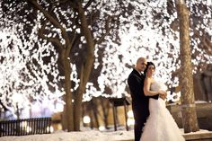 Beautiful photo idea for a winter wedding. Love the white Christmas lights!