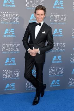 He has perfected the red carpet lean. | OK, But Eddie Redmayne Is This Awards Season's Best-Dressed Babe