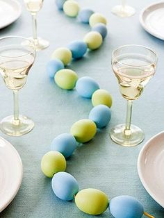 DIY- Last minute solution for Easter table decor, a bag of foam eggs strung together, color them in any color to match your table display. Simple yet effective.
