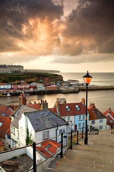 Stormbringer, Whitby  Stormclouds gather at sunset over the pretty Yorkshire seaside town of Whitby.  Location: whitby, yorkshire coast  Photographer: chris ceaser