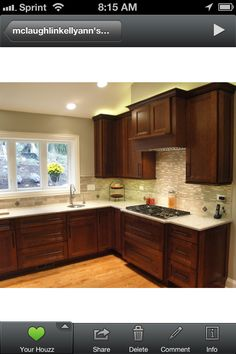 {Kitchen} The total look: Restain cabinets dark, add backsplash, paint walls beige, floors already look like that.