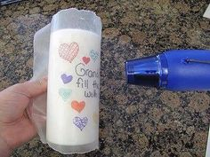 """This is awesome! This would be a great """"sentimental"""" gift, Mother's day, Grandparent's day, Birthday's, etc  Draw on wax paper with permanent markers, wrap around candle and heat until image is transferred... I never would have thought it would be so easy! Would make a great DIY gift!!!"""