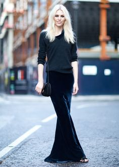 Splash into the street  If there was a way to look like a mermaid in winter, Aline Weber has found it. And she didn't require any sequins, or starfish prints, or fish scales. Just a long velvet skirt that tails out, subtly, that shimmers, even more subtly… and hair worn out with a centre part for a flowing, Siren-like feel.    But the best magic trick of all is making a floor-length velvet gown oh-so-right for the daytime: just add a casual knit with rolled-up sleeves and away you go.