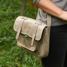 Leather satchel bag.  This everyday bag has enough space inside for a small tablet, notebook, purse, diaries.  It is perfect for walking, meeting with friends and having a pleasant time on weekends.