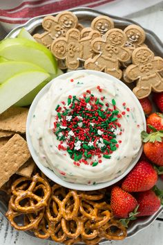 This Christmas cookie dough dip has a fluffy and creamy base that's swirled with plenty of holiday sprinkles and served with fruit and cookies for dipping.