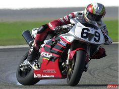 Nicky Hayden a long time ago. Slide's his Honda RC51 to the checkered flag!