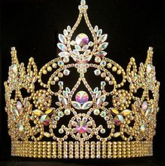 CONTINENTAL RHINESTONE GOLD AURORA BOREALIS CROWN TIARA RHINESTONE BEAUTY QUEEN CROWN Genuine Swarovski crystals give this crown a beautiful sparkle and extravagant look! This beautiful majestic crown