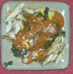 Sliced leftover organic chicken with organic yellow squash, collards, and tomato sauce with extra virgin olive oil.