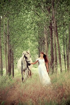 Beautiful! Engagement and/or wedding photo. Perhaps for engagement have the two of them coming closer with horses and then wedding, hubby leading her with her on horse.